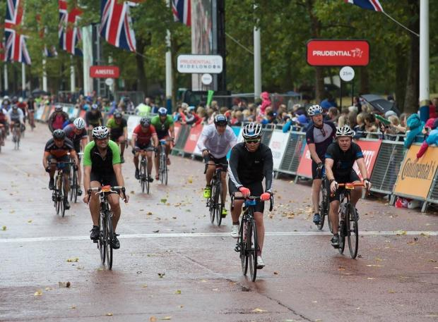 Surrey Comet: The rain didn't deter riders or spectators on Sunday, July 30. © Keith Larby/AK Photos
