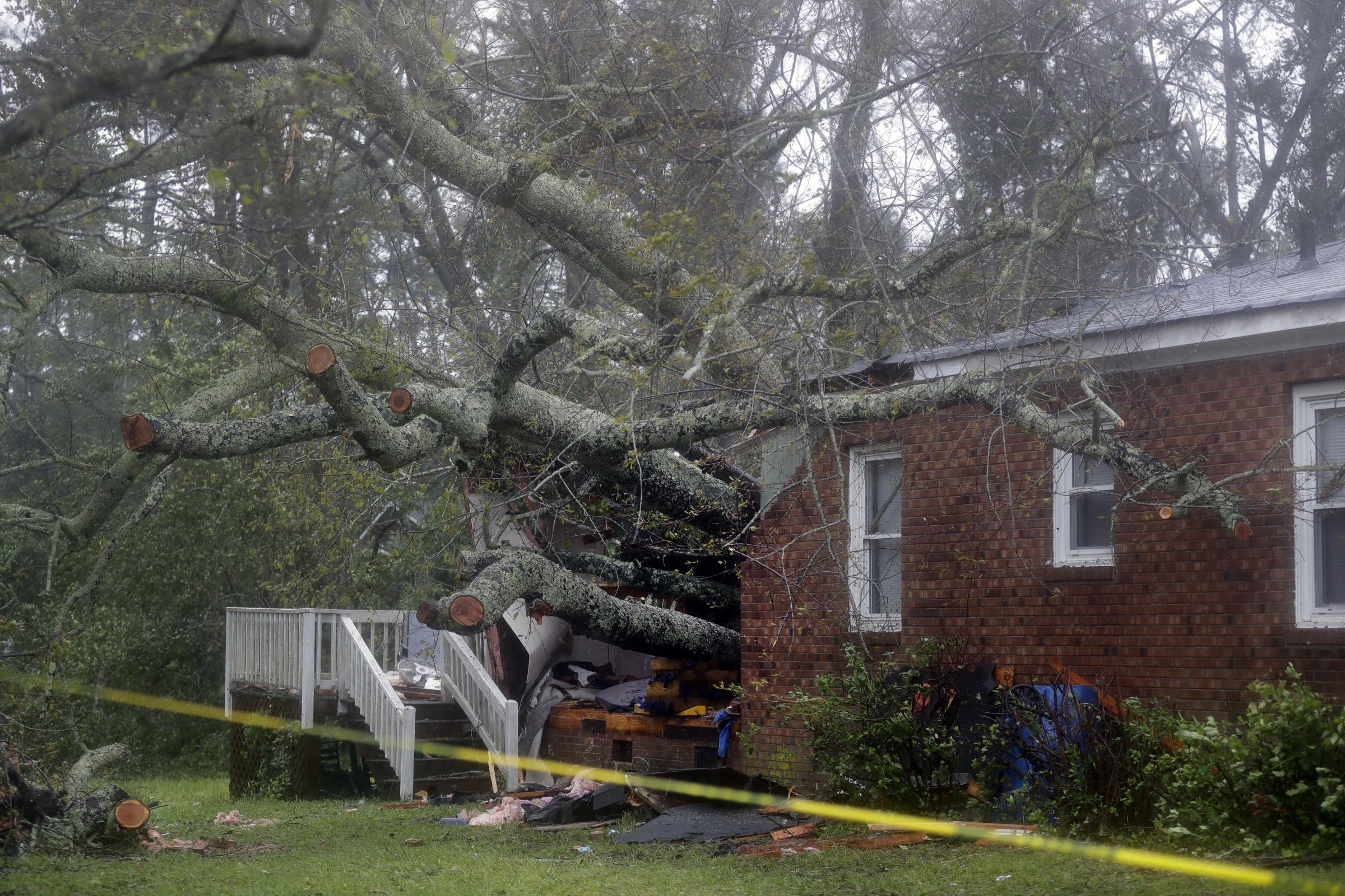Image result for A mother and her infant were killed in Wilmington when a tree fell on their home on Friday. Officials say the child's father was also transported to hospital for injuries Two men in their 70s were killed in Lenoir County. One was killed when connecting an electrical generator, and family members say another man was killed in a wind-related death when checking on dogs outside his property A woman died from cardiac arrest in the town of Hampstead after emergency responders had their route to her blocked by downed trees, a county official said