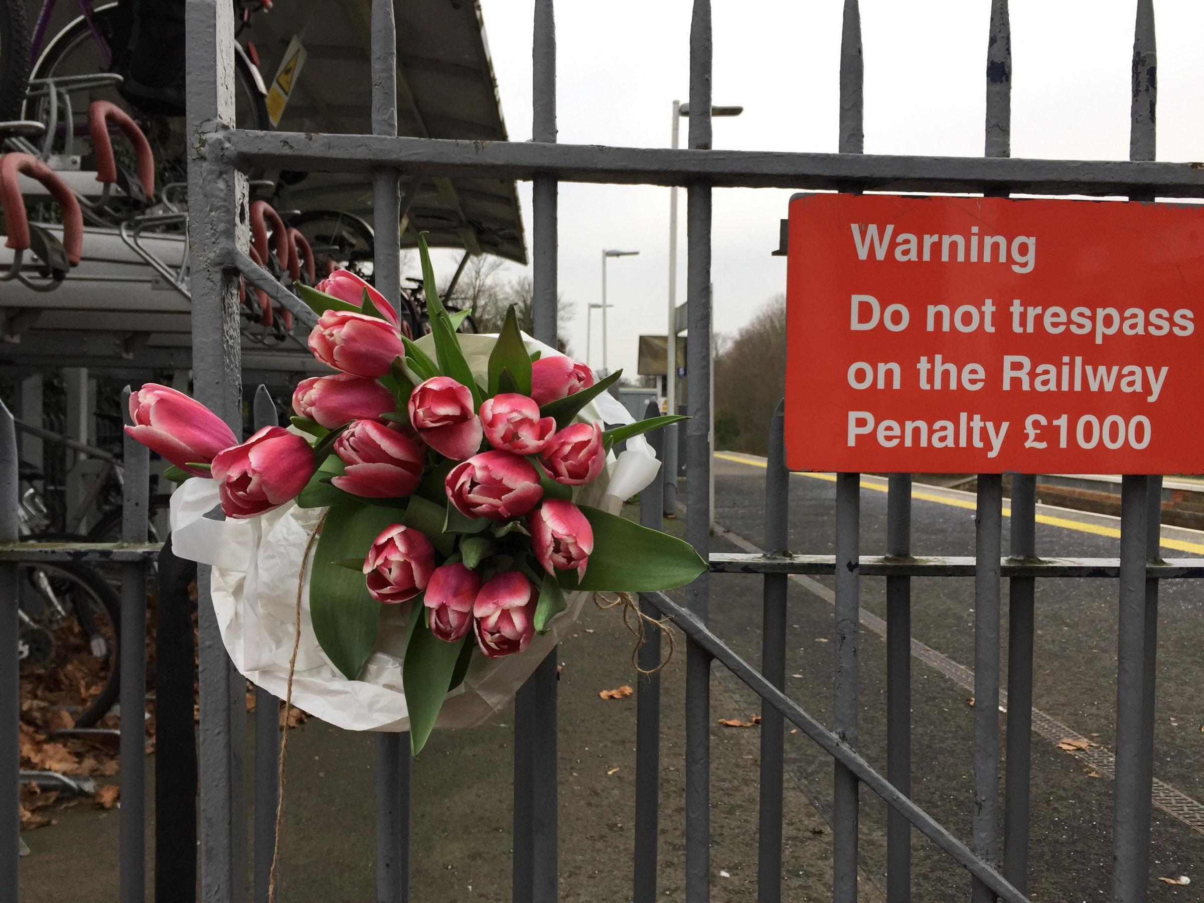 Flowers left at Horsley station near Guildford, Surrey, after a train passenger was stabbed to death in front of his 14-year-old son.  Picture: Lizzie Roberts/PA Wire