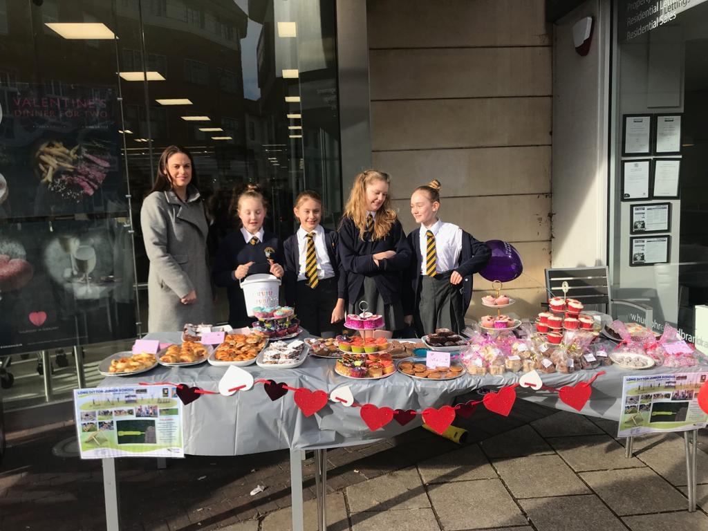 Pupils from Long Ditton at their cake stand last month